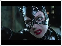 The red of Catwoman's lips really pop in all of her scenes due to the muted palette of the film's sets.