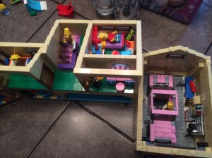 A bird's eye view of Bart's room and part of Lisa's, as well as the garage. Grandpa is apparently over for a visit.